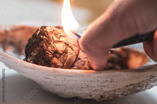 Fotomural White sage burns for a spiritual cleansing practice
