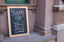 A Humorous Hand-lettered Chalk Board Outside Of A Restaurant Recommends Several Ways To Celebrate The End Of January.