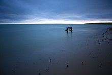 Peaceful Bench In Water At Bea...