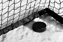 A Hockey Rubber Puck Lies In T...