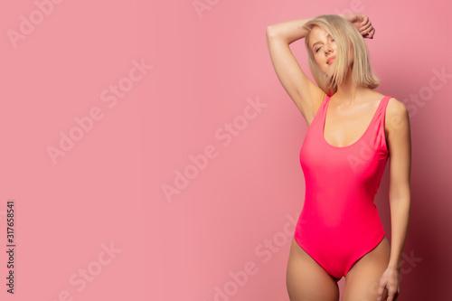 Fotografie, Obraz Beautiful blonde woman in red swimsuit
