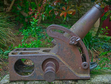 Old Vintage Rusted Mortar Canon With Greenery In Background