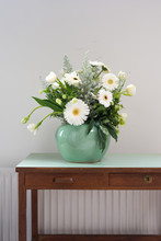 Bouquet With White Gerbera Flowers In A Green Vase