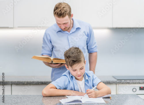 Fotografía Father and son do school homework at home