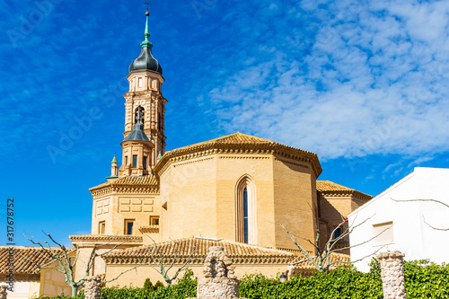 Photo View of the apse and the top of the Baroque style bell tower of the church of St