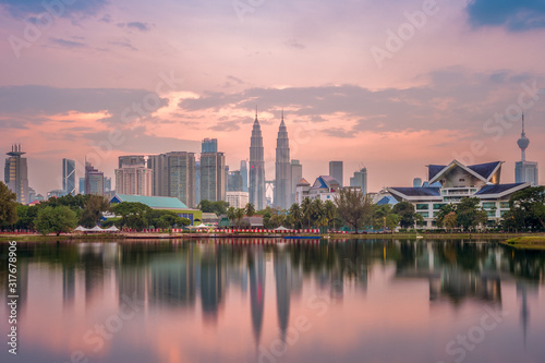 Skyline of Kuala Lumpur by the lake at dusk Wallpaper Mural