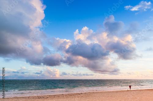 A man walks the beach of Bavaro at sunrise #317679104