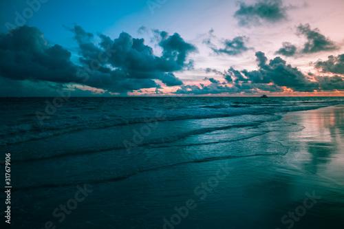Tropical sunrise over Atlantic Ocean, Bavaro beach, Punta, Dominican Republic #317679106