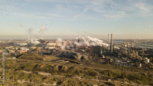 Fotografia, Obraz Factory Tata Steel with smoking chimneys on a sunny day, IJmuiden, The Netherlan