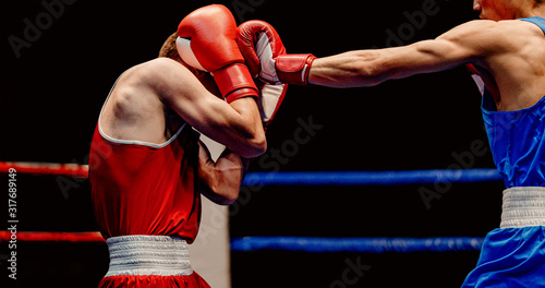 Photo boxer lands left jab to head through his gloves