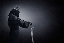 Ghost Of A Queen Or King With Medieval Sword In The Dark