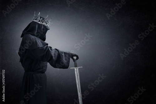 Ghost of a queen or king with medieval sword in the dark Wallpaper Mural