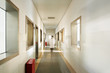 people walking in the corridor of hospital laboratory, blur motion