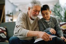 Grandfather Teaching His Grand...