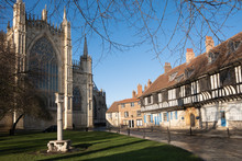 York Misnster Yard, An Ancient Sundial On Top Of A Column, Half-timbered Houses And The East Front Of The Great Cathedral