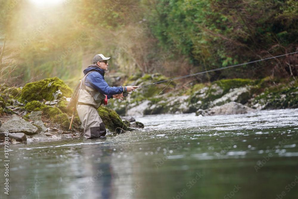 Fototapeta trout fly fisherman in river