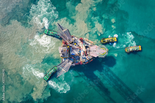 Aerial view of Drilling oil rig move operation at oil field industry with towing Wallpaper Mural