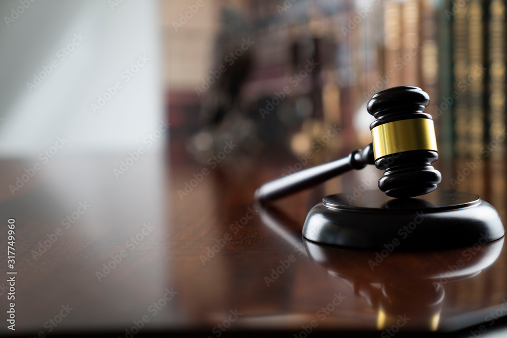 Fototapeta Law and justice theme, judge's gavel on court library background