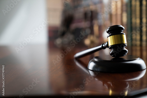 Obraz na plátně Law and justice theme, judge's gavel on court library background