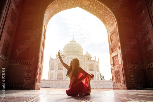 Indian woman in red saree/sari in the Taj Mahal, Agra, India Wallpaper Mural