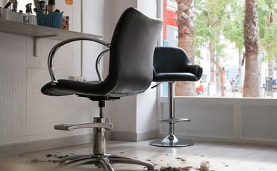 Cut hair on the floor in a hairdressing salon