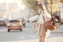 Happy Girl With Flowers In The City / Summer Photo Young Beautiful Girl Holding A Bouquet Of Flowers On A City Street