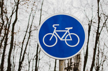 A Blue Bicycle Sign Sign Signi...