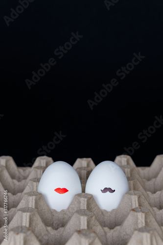 Obraz na plátne Eggs mr and mrs, painted mustache and lips on an eggshell, couple concept