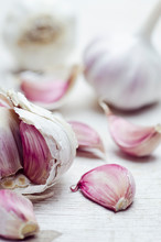 Close Up Of Garlic Bulbs And C...