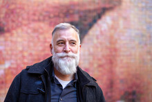 Older Man With White Beard Loo...