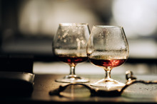 Two Glasses Of Cognac On Wood...