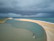 Benin, Grand Popo, Aerial View Of Storm Clouds Over Sandy Beach Of Mono River