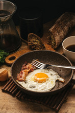 Russia, Saint Petersburg, Fried Egg And Bacon On Frying Pan