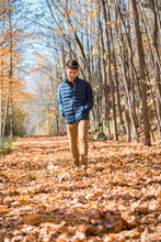 Teenage Boy Walking Alone Thro...