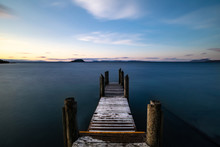 Wooden Pier Over Calm Waters A...