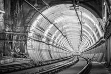 Circular Railway Tunnel With Lights And Rails