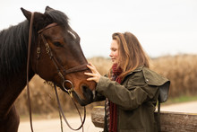 Young Horsewoman With A Horse ...