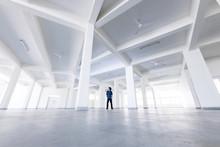 Man Standing In Empty Building