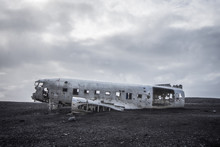 Abandoned Airplane Wreckage Against Sky