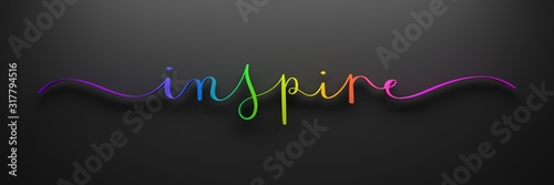 Photo 3D render of rainbow-colored INSPIRE brush calligraphy on dark background