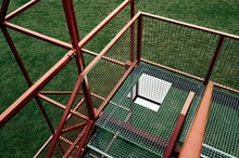 High Angle View Of Metallic Staircase On Grassy Field At Playground