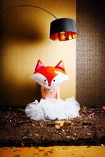 CLOSE-UP OF GIRL Holding Fox Balloon