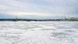 Panorama of famous tourist attraction Neva river covered with ice.