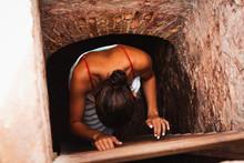 Girl Climbing Down Ladder Of A...