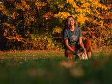 Woodlawn Cir And Opp Indian Hill St, East Hartford, CT 06108, USA - 11/04/2019. Enjoying The Fall Foliage, Girl/teen/women Plays Catch With Mini Aussie/Australia Shepherd Dog.