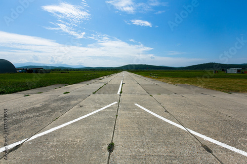 Cement runway at a village airfield Canvas Print