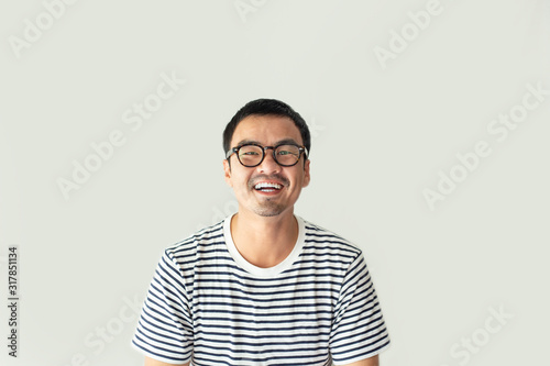 Fototapeta portrait young asian man wear eye glasses Smiling cheerful look thinking position with perfect clean skin posing on white background.fashion people freedom life style concept obraz