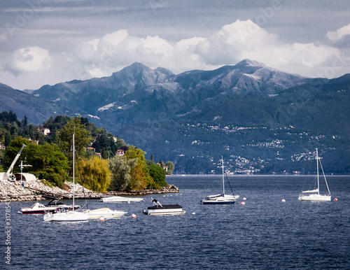 Sailboats at anchor framed by mountains on Lago Maggiore, Piedmont, Italy