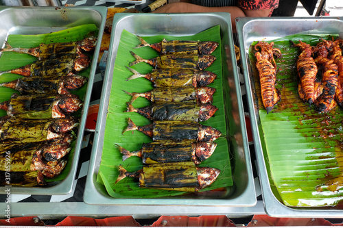 Fotografija Grilled torpedo scad inside the tray sell at the restaurant for tea time