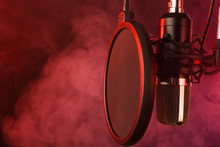 Close-up. Studio Condenser Microphone Radio, Vocals, Podcasts Red Smoke. Copy Space.